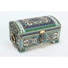Russian Silver and Enamel Casket, with panels of foliate arabesques within multiple patterned geometric borders, enameled in green, white, red and shades of blue; the curved hinged cover set with a hinged clasp and the box set with shaped drop handles, on four stepped bracket feet, bearing comprehensive Russian marks, h 7.5 x w 12.8 x d 8.2cm, total weight 677g.