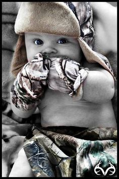 Camo baby. This is precious. I'm def getting my baby that hat!