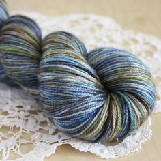 """""""Winterfell"""" in sky to deep, icy blues; mossy greens, earth and bark brown; granite grey; snow white and hints and bits of golds, green, violets, etc.  Brand, and I mean BRAND, new at Phydeaux Designs - order in any of Phydeaux's base  yarns  (click through the photo for more details).  :)"""
