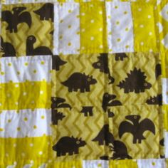 How can you give a handmade baby quilt and make it an affordable baby shower gift?