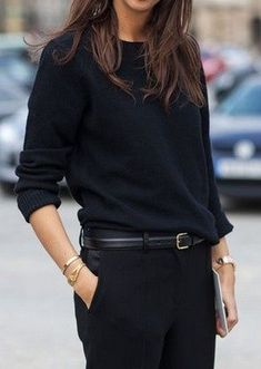 black on black blouse and tailored belted trousers.