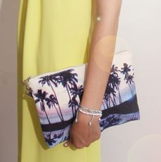 We love Palm Tree print this season, check out this lovely pouch in Blue and Prange combos, style with palysuit or sport luxe sweatshirt & denim shorts, go to our online shop www.lindasbang.com