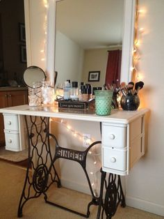 Love this idea. Old sewing machine turned makeup table. Very vintage. Singer stand make-up table