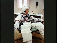 Astronaut Jim Lovell gets a check up while suiting up for his Gemini 7 mission with Frank Borman. Lovell and Borman would fly together again on Apollo and Lovell would command the ill-fated Apollo 13 mission