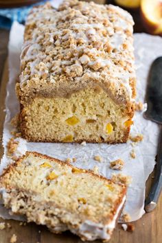 Peach Cobbler Loaf Cake - tender, soft vanilla cake that has pieces of fresh peach throughout. It's topped with a sweet, brown sugar crumble topping and a drizzle of icing.