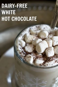 Homemade Dairy-Free White Hot Chocolate that is creamy, rich, indulgent and delicious! Made with just 5 ingredients...coconut milk, real cocoa butter, cashew butter, maple syrup and vanilla! via @thevegan8
