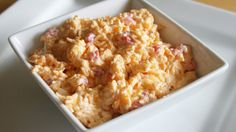 Pimiento cheese is truly a Southern staple. The base of pimiento cheese recipes is always the same—grated cheese, pimiento peppers, and mayonnaise. But the variations of this basic pimiento cheese recipe are what make this Southern indulgence memorable. Homemade Pimento Cheese, Pimento Cheese Recipes, Pimiento Cheese, Cheese Dips, Fondue, Appetizer Recipes, Party Appetizers, Easter Recipes, Dip Recipes