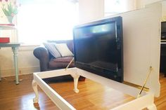 """Hide Your TV"" -- Click through for a variety of good and unusual ideas for hiding your television. Haven't seen one hidden in a table before!"