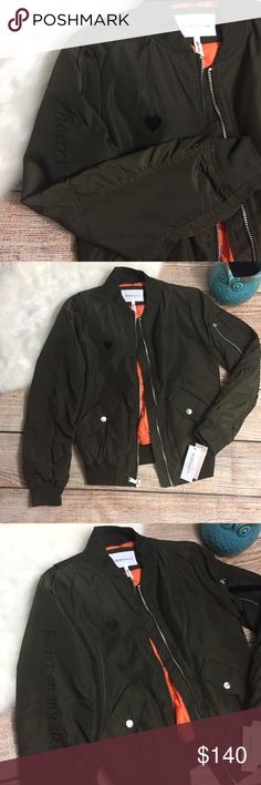 """BCBG """"<3 on sleeve"""" bomber jacket New with tags! BCBGeneration """"Heart on my sleeve"""" khaki olive green bomber jacket w/ orange lining. Wind + water resistant. Cute + comfy! ::N24:: BCBGeneration Jackets & Coats Puffers"""