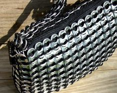 This unique handbag is made from post-consumer recycled (clean) aluminum beverage can tabs and black nylon crochet cord. It is lined with black Pop Tab Purse, Clutch Purse, Pop Top Crafts, Soda Tab Crafts, Pop Can Tabs, Soda Tabs, Crochet Cord, Pop Cans, Etsy