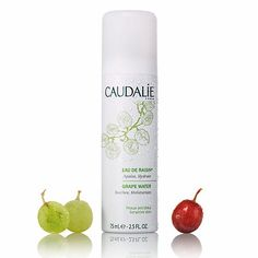 Caudalie Grape Water. I have purchased multiple cans of this. It has a fine mist and is a nice way to get rid of any powderiness from makeup. I hate facial sprays with alcohol and this has none.