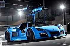 Gumpert Apollo  Model year: 2012  Top speed: 225 mph (362 km/h)  Engine: 4.2 L (260 cu in) twin-turbocharged V8 (650 hp)