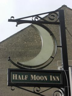 Half Moon Inn pub sign - Sherborne, Dorset, UK by Bridgemarker Tim