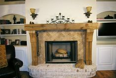 like the wood, would use stone instead of brick--stone fireplace with timber mantel | HGTV shows off distressed mantels in their Dream Home 2006