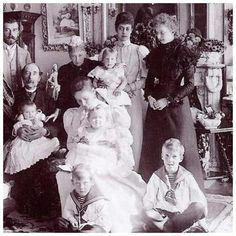 Tsar Nicholas ll of Russia,Empress Alexandra Feodorovna of Russia with baby Grand Duchess Olga Nikolaevna Romanova of Russia and her great grandparents,King Christian lX of Denmark and Queen Louise of Denmark..Also in the photo is Princess Victoria of Wales.