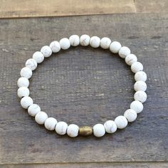 Add texture to your stack with this simple, yet beautiful howlite bracelet with a tiny hand made African trade bead for detail. Howlite is a calming stone and many people use it to relieve stress. - S