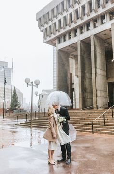 Cannolis, snow, rings, oh my! This winter wedding at Boston City Hall was simply perfect. The bride wore a knee-length lace dress and camel peacoat, the groom rocked a black suit, and they shared a cute clear umbrella to hide from the rain and snow! To warm up, they shared limoncello and cannolis at Caffe Vittoria in the North End of Boston. Rain, shine, wind, snow, Boston is the BEST place to elope! Check out more of Lena Mirisola's epic city elopements. City Hall Wedding, Post Wedding, Wedding Photos, Boston City Hall, Boston Public Garden, Newbury Street, Courthouse Wedding, Old World Charm, Couples In Love