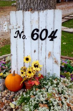 House address sign I made from barn siding milk house gate, paint, and cheap hardware store numbers...