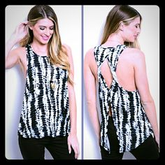 Tie dye tank S Tie dye print tank top with a unique twist back.  Black/white Fabric: 95% rayon 5% spandex.  Small medium and large available.  This listing is for the small.  Discounts offered on bundles. boutique Tops Tank Tops