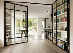 glass room divider doubles as display case