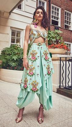 Dhoti jumpsuit embellished with glass beads, neon sequins, enamel stones and metallic charms. Salwar Designs, Kurti Designs Party Wear, Lehenga Designs, Blouse Designs, Indian Attire, Indian Ethnic Wear, Indian Outfits, Indian Wedding Outfits, Stylish Sarees
