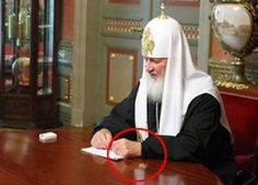 Failed airbrushing away of Russian Orthodox Patriarch's $30,000 watch.