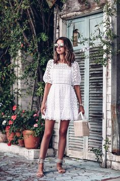 Casual summer outfit - Off the shoulder white eyelet mini dress + Prada basket tote bag