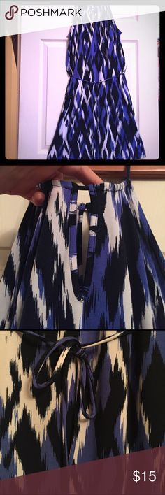 Dress Just in time for spring and summer! This awesome cute dress is easy to wear and has a gorgeous pattern.  Cool, light, and comfortable and simply cinches at the waist by a matching dress string. Banana Republic Dresses Midi