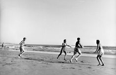 RFK and family playing touch football in Hyannis Port in 1960.   - TownandCountryMag.com