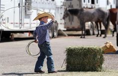 Four-year-old Treston Brazile practices his roping before watching his dad, Trevor Brazile, compete at the Calgary Stampede in the Tie-Down Roping Championships in Calgary, Alberta on July 8, 2012.  Photograph by: Leah Hennel, Calgary Herald.