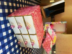 Matchboxes, some modge pode and pretty paper, a lick of paint and pretty bead handles and Barbie has a chest of drawers.