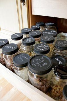 I've got to try this in one of my two deep drawers. Quart canning jars fit perfectly. Store pantry supplies (nuts, small grains, seeds, etc.) here and label with chalk. ALSO keep a Sharpie Marker in the drawer to label the tops of canned goods. SO EASY!!!