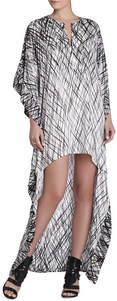 With a draped design and brushstroke pattern, this caftan-inspired dress from Bcbgmaxazria makes a dramatic statement with its high/low hemline and bold black-and-white palette. Caftan Dress, Dress Skirt, Shirt Dress, Latest Fashion Dresses, Moda Plus Size, Mode Hijab, Mode Inspiration, African Fashion, Beachwear