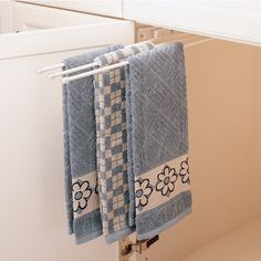Rev-A-Shelf offers two stylish and functional towel holders. Each includes the  required mounting screws, and is very easy to install.