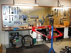 bicycle workshops - Google Search Garage, ideas, man cave, workshop, organization, organize, home, house, indoor, storage, woodwork, design, tool, mechanic, auto, shelving, car.