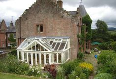 A timber harmony conservatory in a stone frame finish on this period home. #Stunning