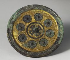 Gilt bronze mirror with animal pattern, Han Dynasty.