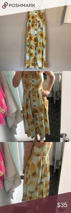 Urban Outfitters maxi sunflower dress! This dress is super cute! A sea foam/mint green dress with yellow sunflowers. It is in perfect condition! I wore once but it's basically NWOT. It was an impulse buy at an UO in London on a trip. Nothing is wrong with it, it just isn't my style. I am 5 ft 2 for reference and it hits right above my ankle. It's a size S. I am 114 pounds and it fits me but it is a little roomy (you can't tell at all). Urban Outfitters Dresses