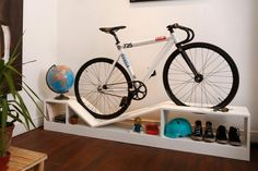 If the amount of space your bike takes up in your tiny apartment is making you nuts, you'll love this collection of bike rack furniture.