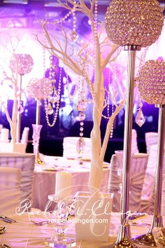 Doesn't get more feminine than this...tree centrepieces with jeweller draped over and a tall, rounded chandelier