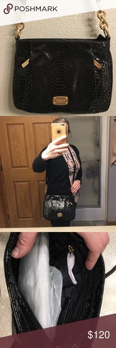 Michael Kors snakeskin pattern purse Black Michael Kors Hallie messenger crossbody purse. Python embossed leather bag. Does not have original tag (missing when it was purchased) but is brand new, never used. Michael Kors Bags Crossbody Bags