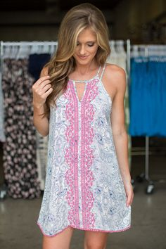 Shop our Just Beachy Sleeveless Dress. Cream colored dress featuring navy print and pink embroidery. Free shipping on all US orders.