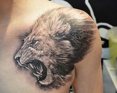 A black and gray tattoo that showcases the wild side of the wearer, an impressive tattoo design of a roaring lion that could scare off anyone.