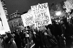 Portland, Oregon, USA - November 11, 2016: An anti-Trump rally - a fourth night of demonstrations. People protesting Donald Trump's victory in the 2016 presidential election. A large crowd is facing off with police in riot gear.
