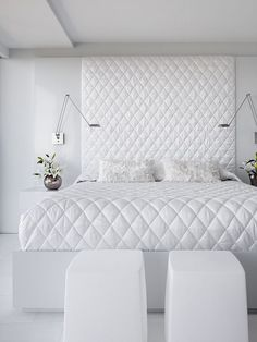 This bed and floor to ceiling headboard is to die for!
