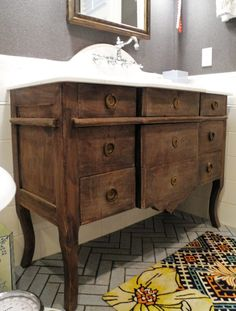 Antique dresser turned bathroom vanity.  Faucet mounted on wall and drains hidden inside it.