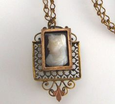 Soooo pretty.    Victorian Cameo Mourning Necklace Hair by VintageJewelsAndMore, $165.00