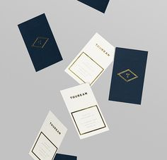 Business card with gold foil detail for British multinational venture capital firm Tourean designed by Anagrama.