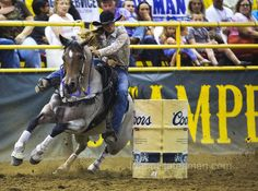 Sarah Rose McDonald of Brunswick, Georgia rounds the second barrel in the barrel racing event Friday July 17, 2015 during the 100th anniversary of the Snake River Stampede at the Ford Idaho Center in Nampa.