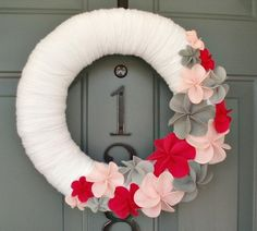 ooooohhh.. i really like this one i love the flowers for sure... for the summer wreath
